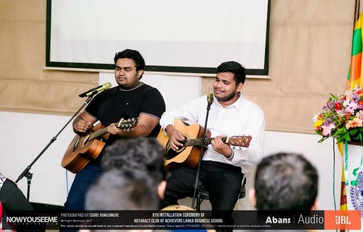 Nelaka and Minesh performing.